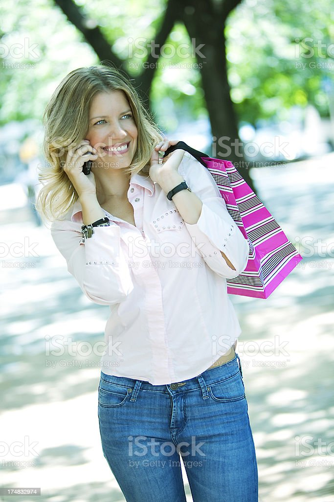 Happy Woman with Shopping Bag royalty-free stock photo