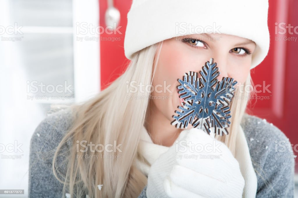Happy woman with snowflake ornament stock photo