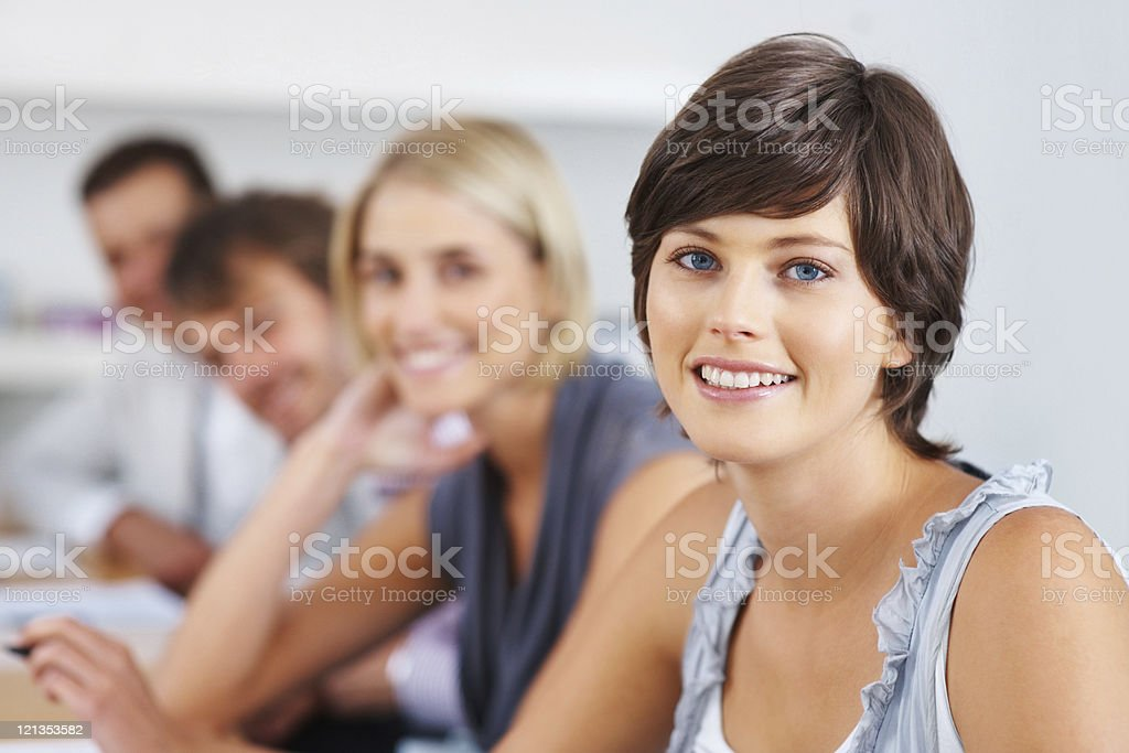 Happy woman with supporting team royalty-free stock photo