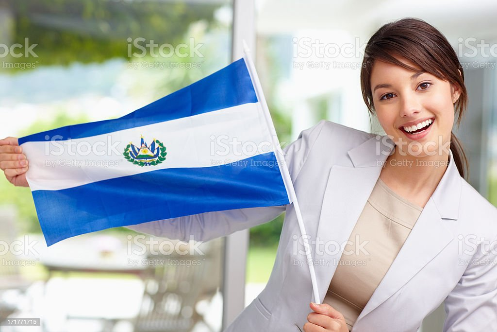 Happy woman with the flag of the republic of El Salvador stock photo