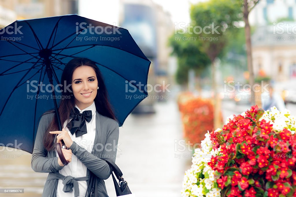 Happy Woman with Umbrella Out in the City stock photo