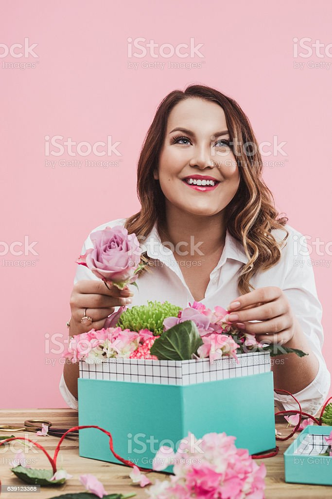 Happy woman with valentines flowers gift stock photo