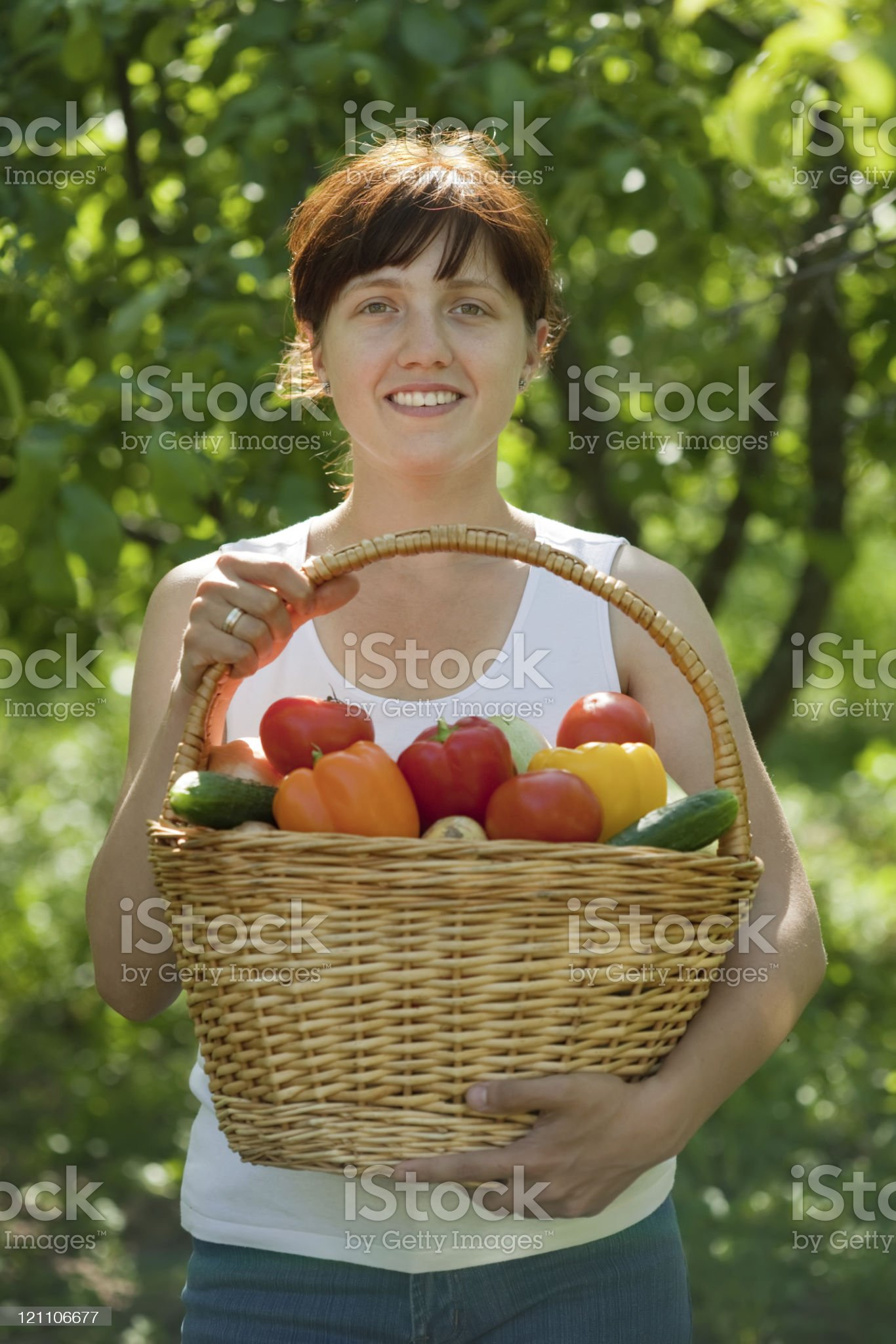 Happy  woman with vegetables  in garden royalty-free stock photo