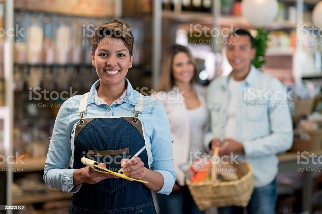 Happy woman working at a supermarket stock photo