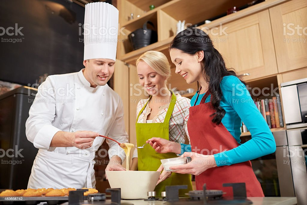 happy women and chef cook baking in kitchen stock photo