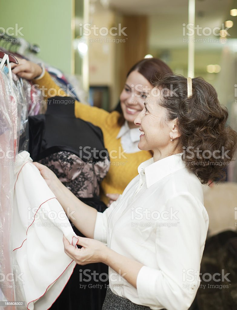 happy women chooses evening gown royalty-free stock photo