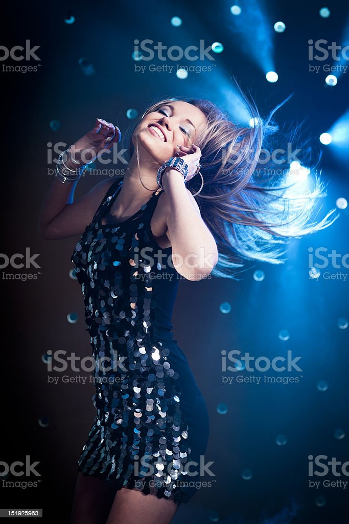 Happy women dancing on smoky disco background stock photo