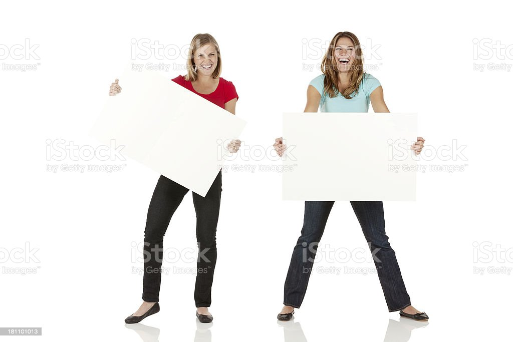 Happy women holding placards royalty-free stock photo