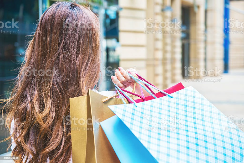 Happy Women holding shopping bags stock photo