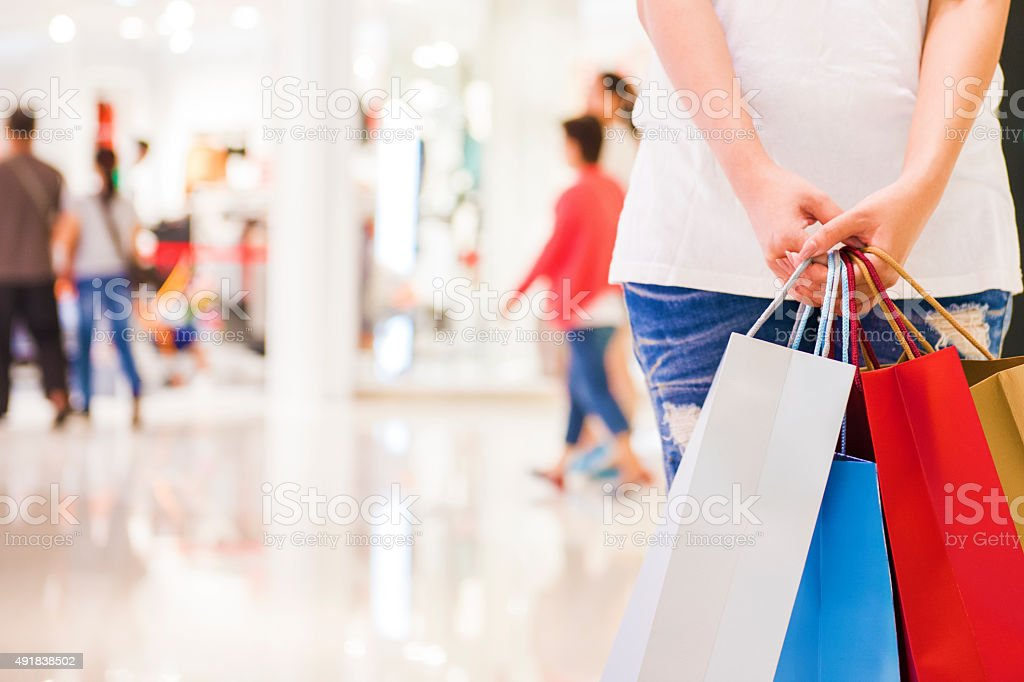 Happy Women holding shopping bags stock photo