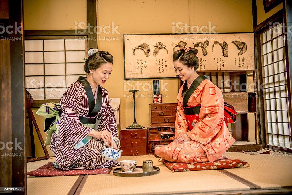 Happy Women in Kimono Drinking Matcha Tea, Kyoto, Japan stock photo