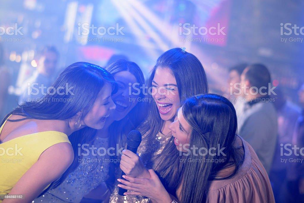 Happy women karaoke singing stock photo