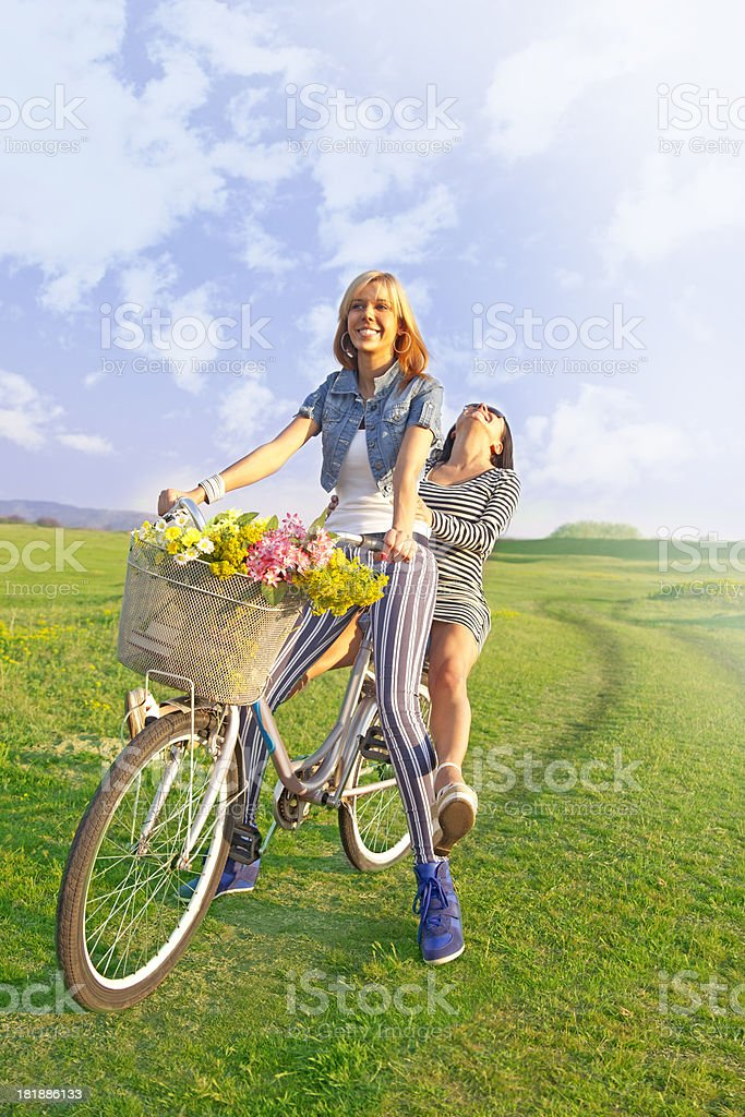 Happy women on cycle ride in countryside - leisure royalty-free stock photo