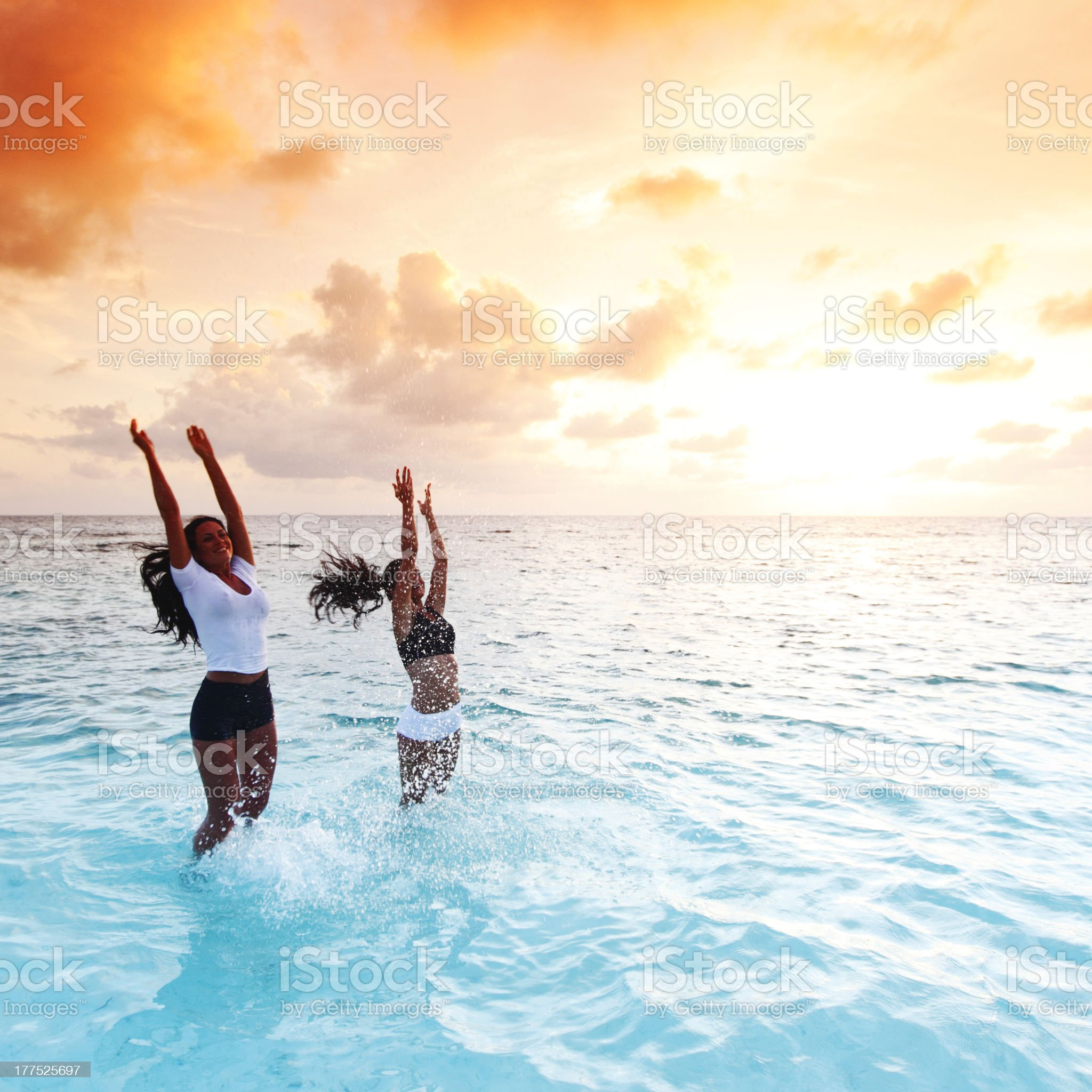 Happy women playing in water royalty-free stock photo