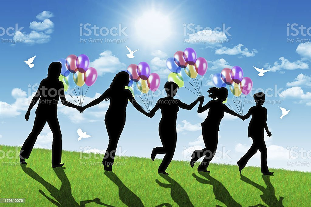 happy women running down the hill with colorful balloons royalty-free stock photo