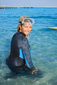 Happy women scuba diver enjoying in the sea