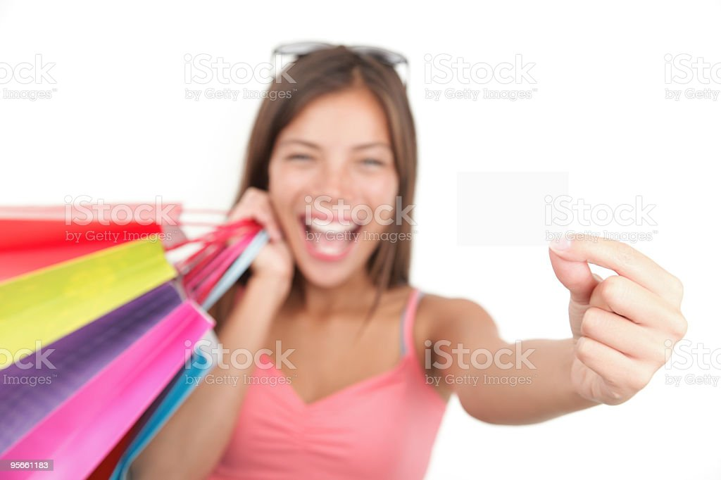 A happy women smiling who has just been shopping royalty-free stock photo