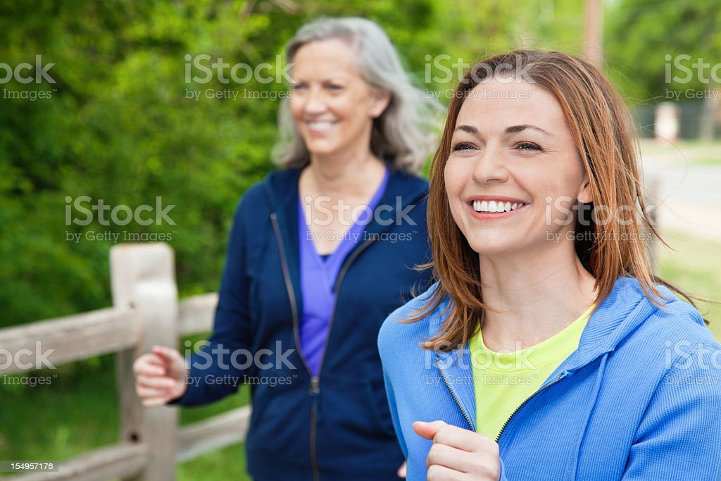 Happy Women Walking Outside on a Park Path royalty-free stock photo