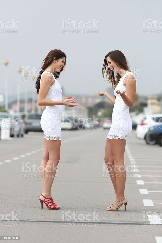 Happy women wearing the same dress stock photo