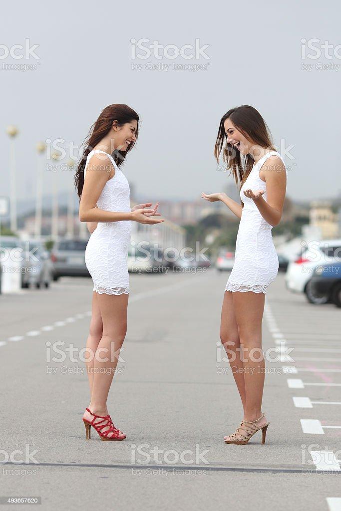 Happy women wearing the same dress stock photo