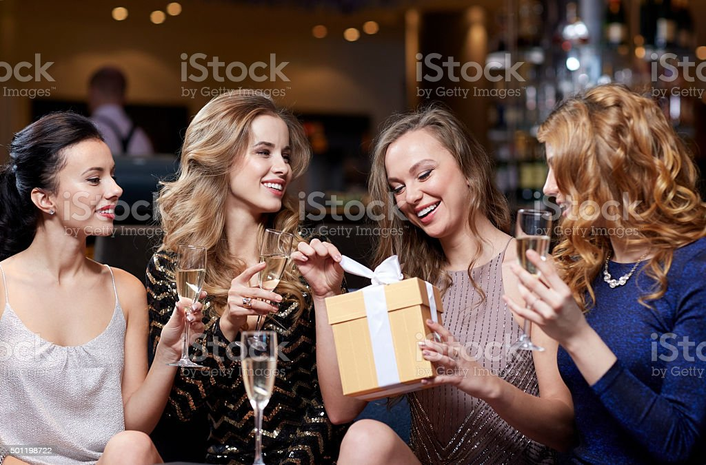 happy women with champagne and gift at night club stock photo