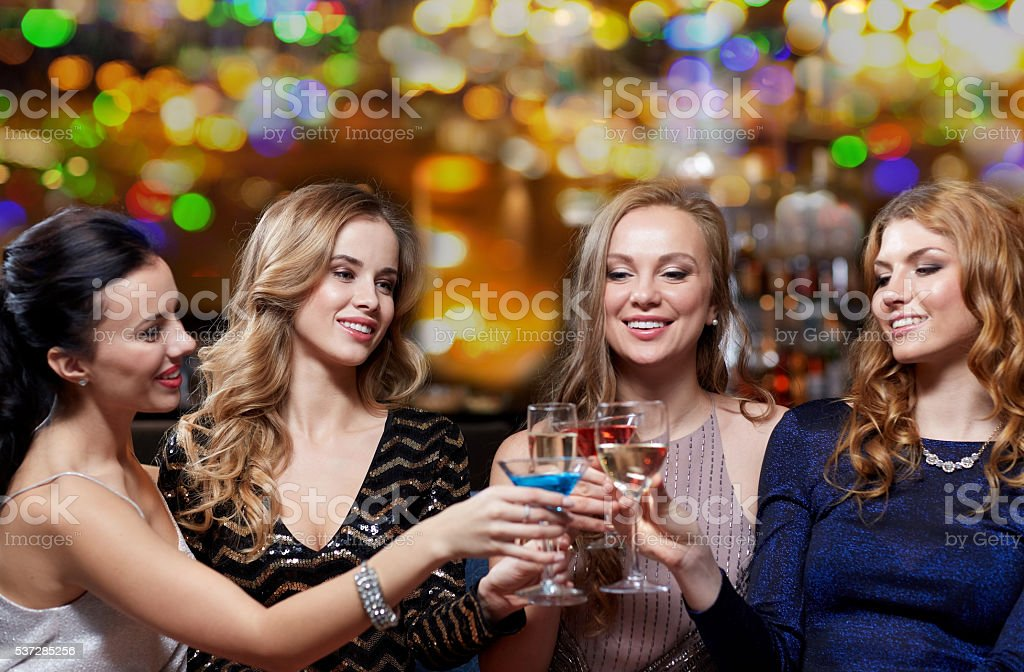 happy women with drinks at night club stock photo