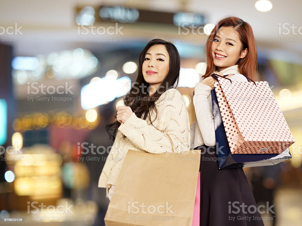 happy women with shopping bags stock photo