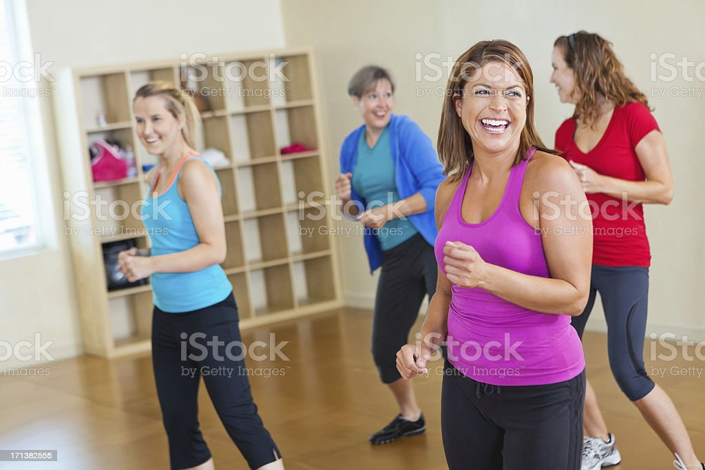 Happy women working out together in fitness exercise class stock photo