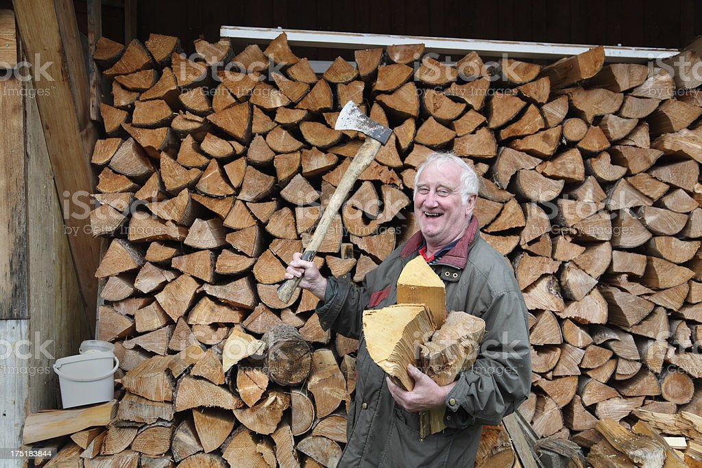 happy woodcutter farmer with logs and axe stock photo
