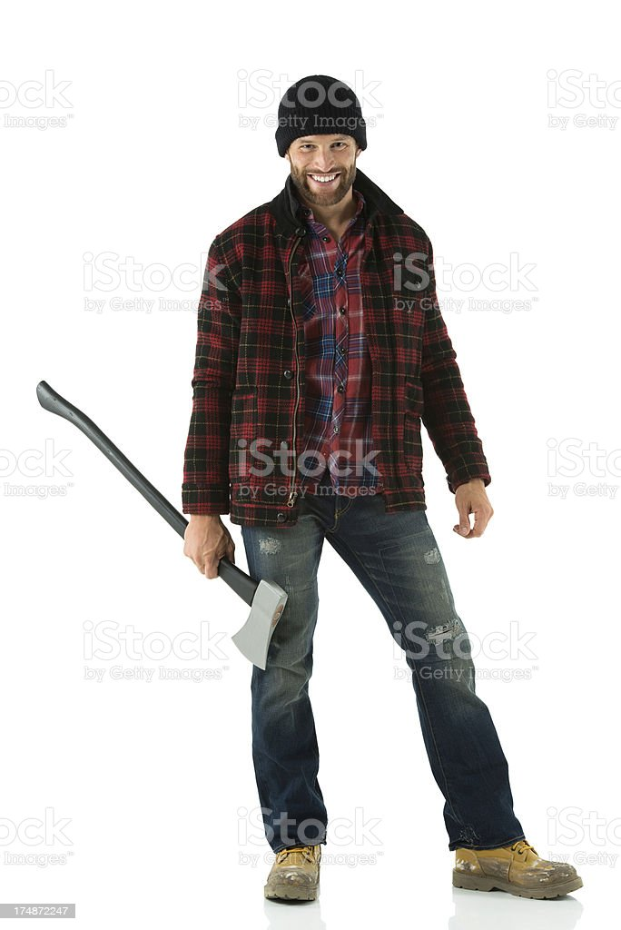 Happy woodcutter holding an axe royalty-free stock photo