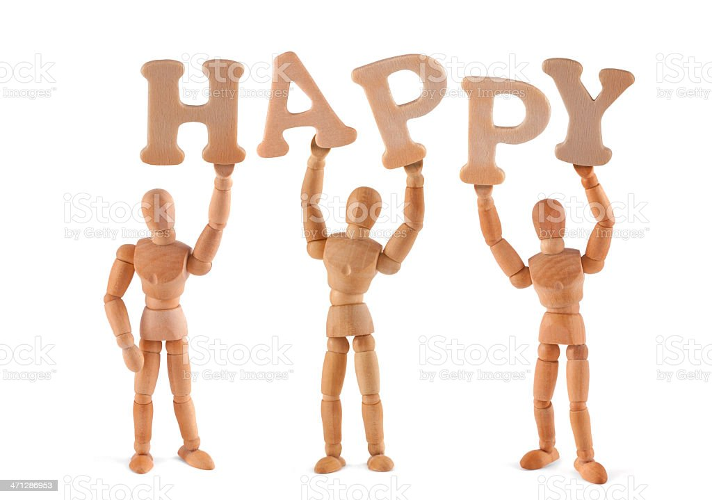 Happy - wooden mannequin holding this word stock photo