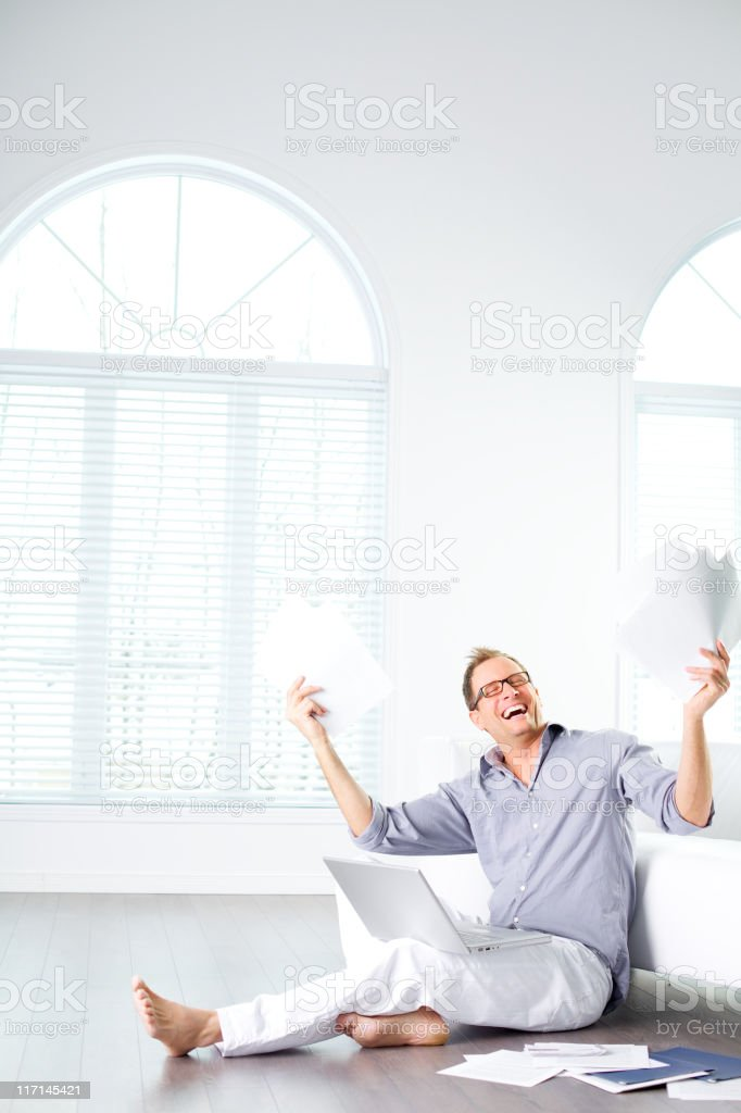 happy  worker at home sitting on the floor royalty-free stock photo