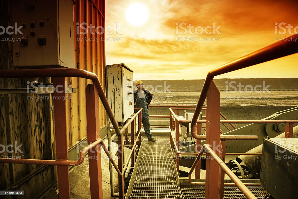 Happy worker on drill machine stock photo