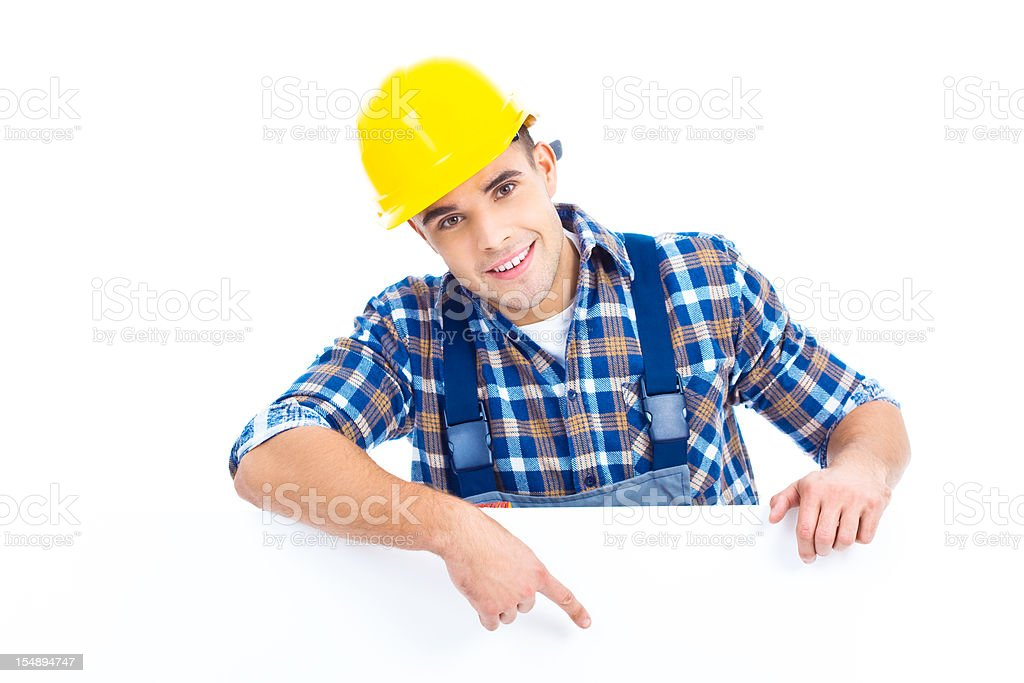 Happy worker with blank sign royalty-free stock photo