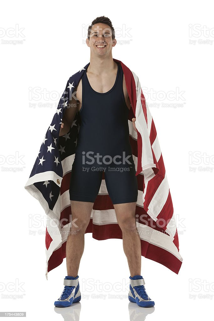 Happy wrestler with American flag stock photo