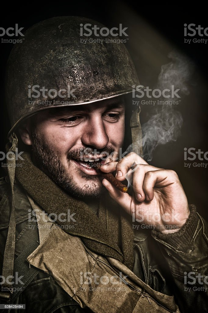 Happy WWII Soldier Smoking A Roll Your Own Cigarette stock photo
