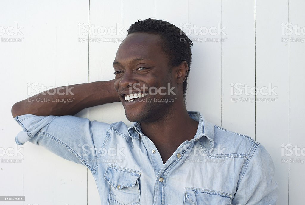Happy young african american man smiling against white background royalty-free stock photo