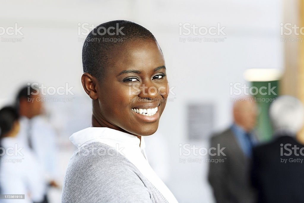 Happy young African business woman smiling at office royalty-free stock photo
