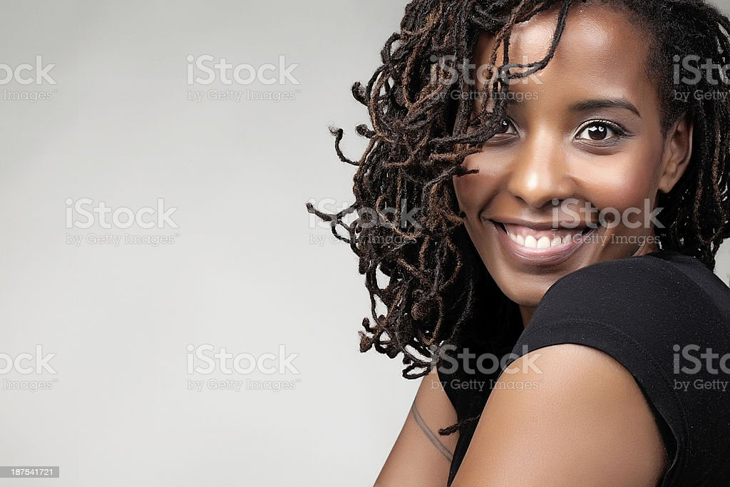 Happy young African female smiling at the camera stock photo