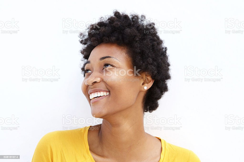 Happy young african woman looking away stock photo