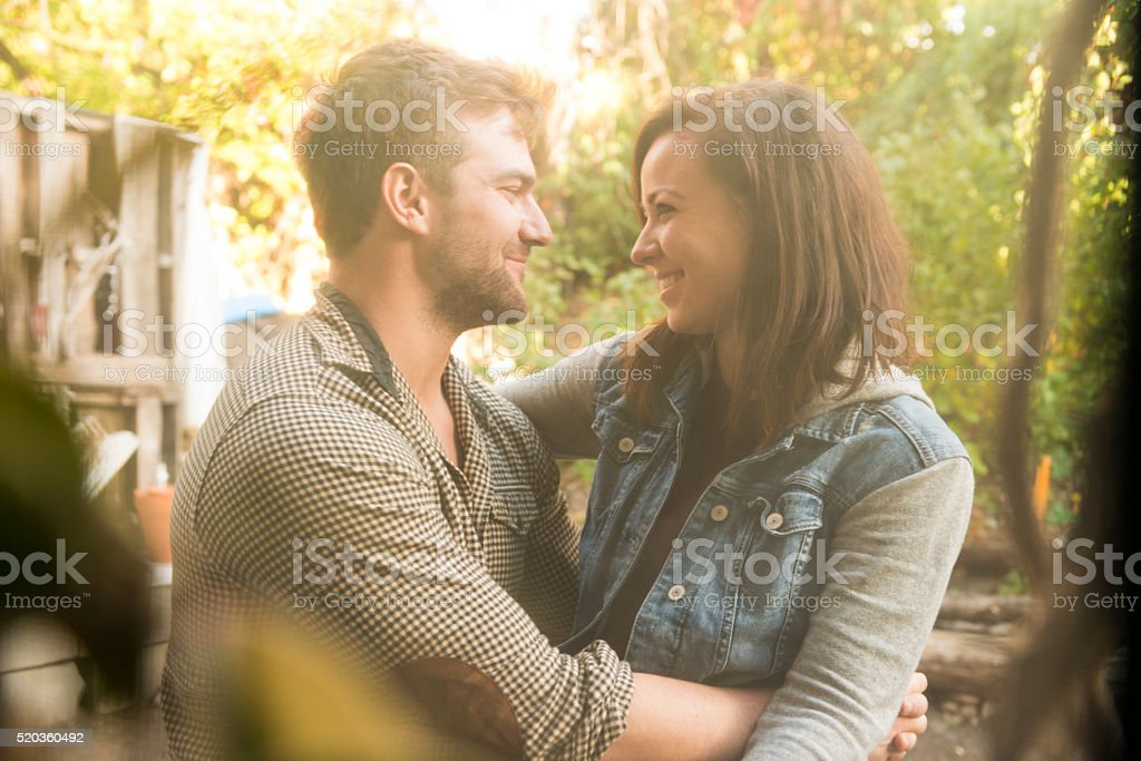Happy Young American Couple in Love Sitting Outdoors stock photo