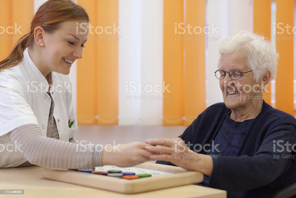 happy young and old woman playing game royalty-free stock photo