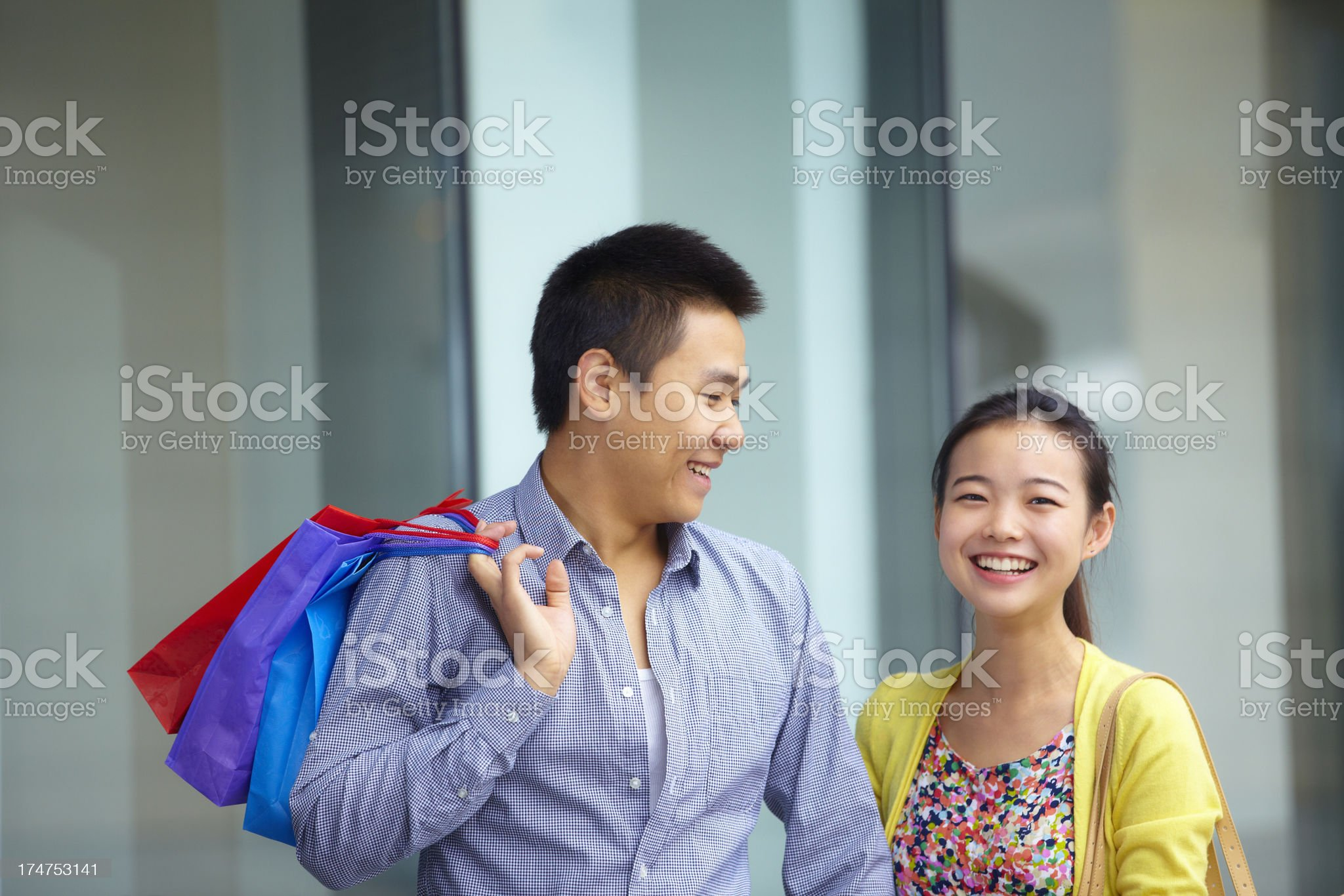happy young asian couple shopping together royalty-free stock photo