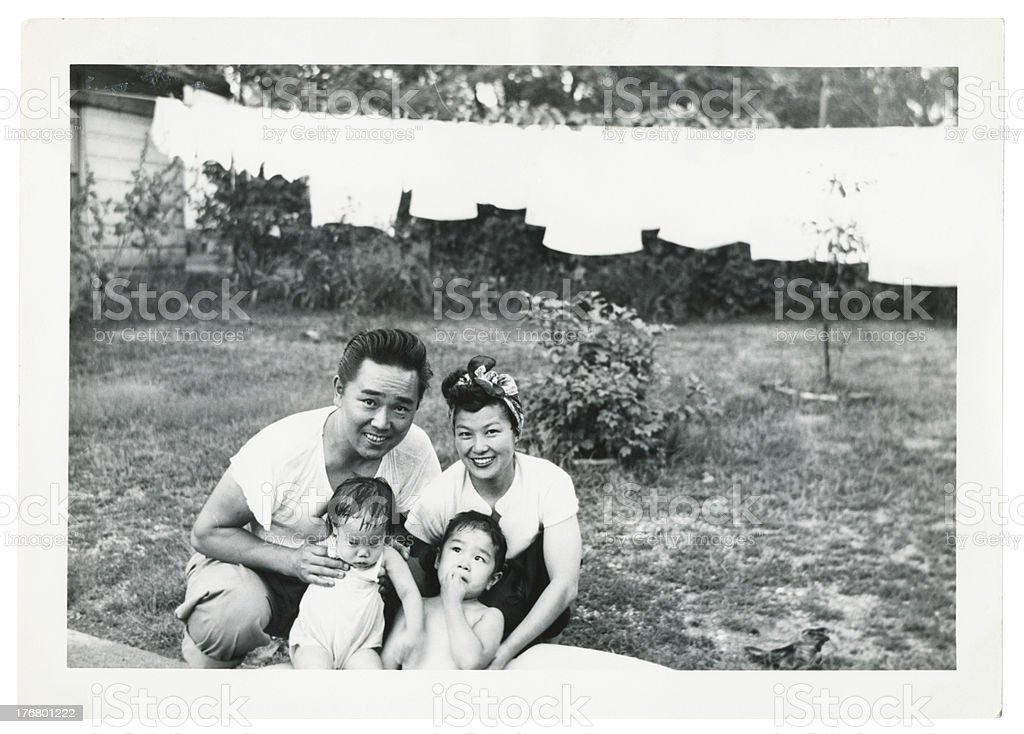 Happy Young Asian Family Outside stock photo
