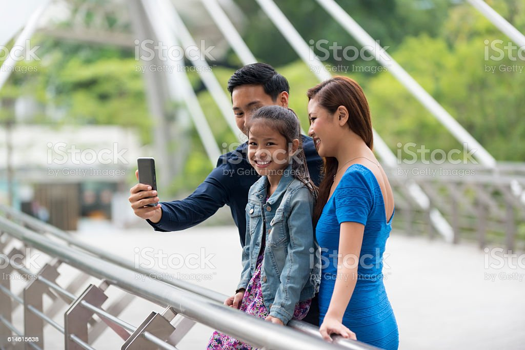 Happy Young Asian Family Taking a Wefie stock photo
