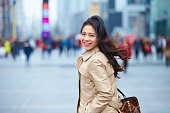 happy young asian woman in street