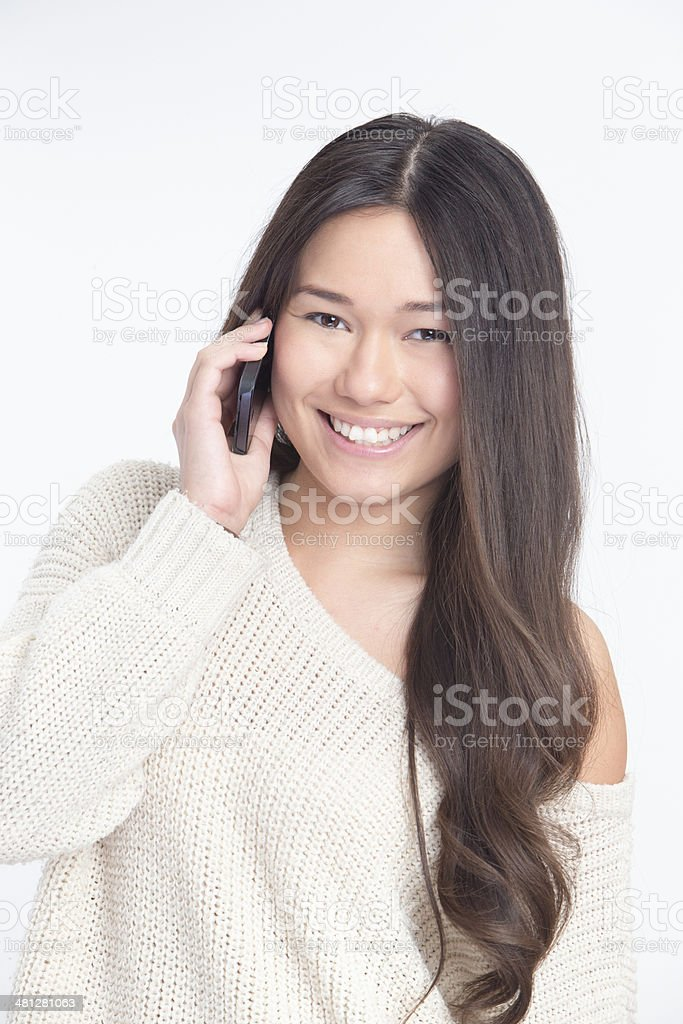 Happy Young Asian Woman on the Phone royalty-free stock photo