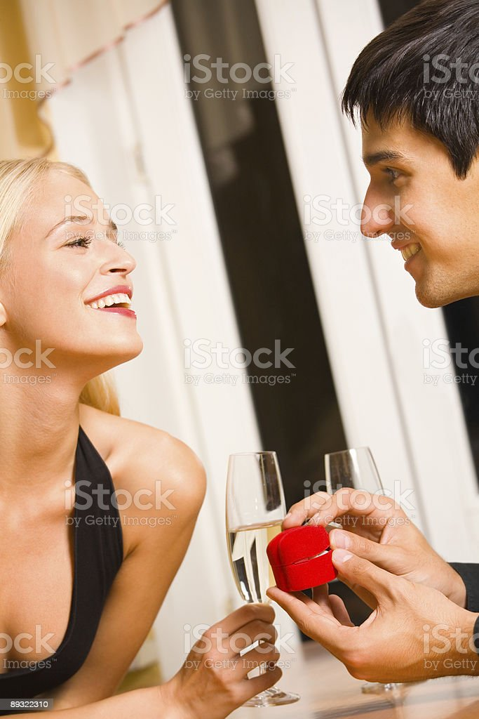 Happy young attractive couple and special proposal royalty-free stock photo