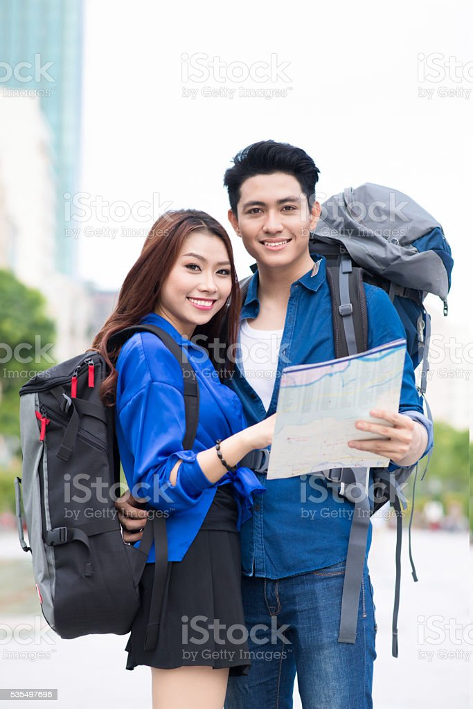 Happy young backpackers in the city stock photo