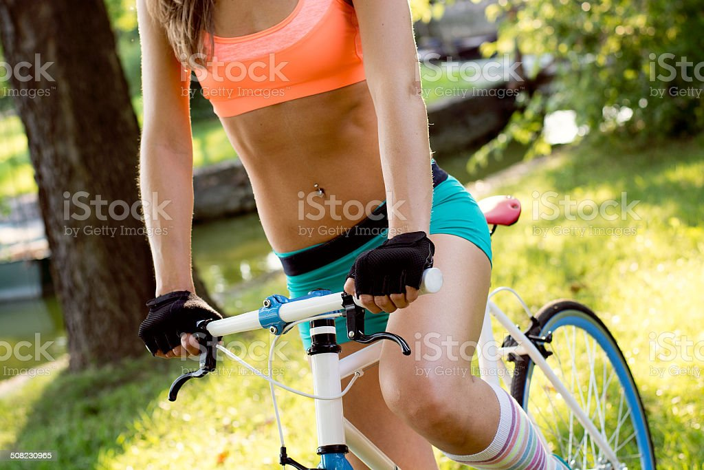 happy young bicyclist riding in park stock photo
